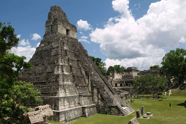 Tikal pyramid raising above the tree canopy